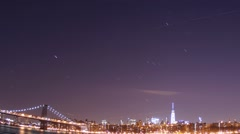 Time-Lapse of Star, Airplane, and Aviation trails above Downtown New York City - stock footage