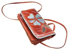 Little brown clutch bag decorated floral pattern Stock Photos