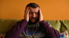 Man having a terrible headache  - stock footage
