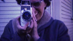 1961: 60's style eyeglasses women filming 8mm movie camera. Stock Footage