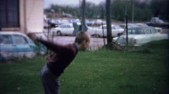 1962: Teenage boy dad toss horseshoes clowning around at park. - stock footage