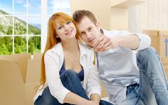 Happy couple celebrating their new home, keys in hand. - stock photo