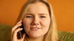 Angry woman talking on the phone    Stock Footage