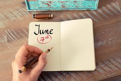 June 7th Calendar Day handwritten on notebook - stock photo