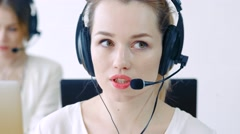 business  concept - helpline operator with headphones in call centre - stock footage
