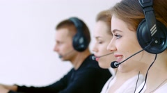 business concept - female helpline operator with headphones and laptop pc - stock footage