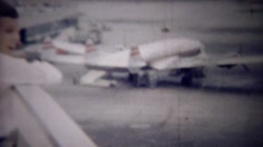 1954: Boy excited about 1st flight on airplane overlooking airport. Stock Footage