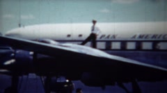 1954: Pilot confidently standing on Pan American Airlines airplane. Stock Footage
