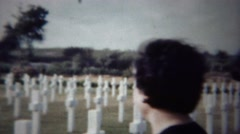 1954: Women visit American soldier cemetery to honor relatives. - stock footage