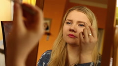 Pertty girl plucking her eyebrows  - stock footage