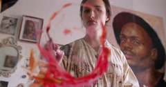 POV of Artist painting with fine brush in her studio - stock footage