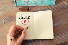 June 1st  Calendar Day handwritten on notebook - stock photo