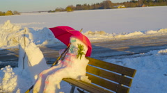 Sideview look of the snowman on the bench - stock footage