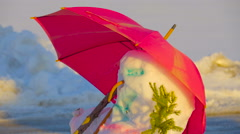 Stock Video Footage of Sideview of the snowman with the pink umbrella