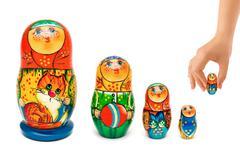 Hand and russian toy matrioshka Stock Photos