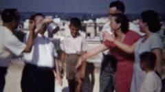 1954: Loud fun Italian family rooftop party sunny daytime follies. Stock Footage