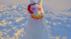 A figure of a rabbit on snow - stock footage