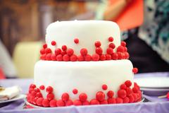 Two-tier wedding cake, decorated in the style of Marsala Stock Photos