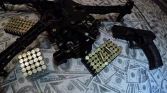 Dolly shot of drone semi automatic 9mm gun pistol 9mm bullets on pile cash 4k - stock footage