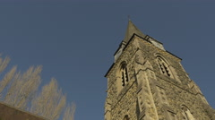 4K Low Angle Church Clock Tower Stone Steeple Stock Footage