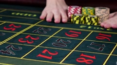 Hands bet chips on roulette snadart and usual table, black - stock footage