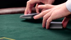 Stock Video Footage of Croupier shuffle the usual cards on green table at casino