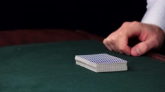 Stock Video Footage of Croupier shuffle cards and shows one on table at casino