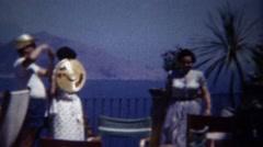 1954: Italian family sunny Mediterranean outdoor restaurant meranda. Stock Footage