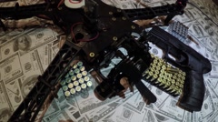 Dolly shot of drone semi automatic 9mm gun pistol bullets on pile of cash 4k Stock Footage