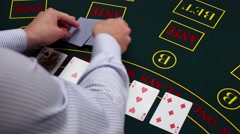 Stock Video Footage of Croupier deal cards on green table at casino, takes away