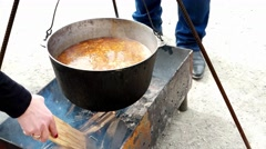 A huge pot of soup cooking in a large casserole - stock footage