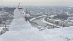 View of a snowman and the cityscape seen from Salzburg Fortress Stock Footage