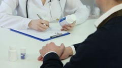 Female therapist prescribing drugs to patient, recommending pills for treatment Stock Footage
