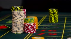 Croupier bets chips on roulette green table at casino, black Stock Footage