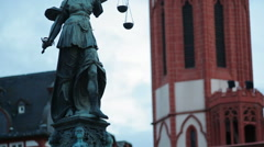 Justitia lady justice statue, Römerberg square, tilt up, Frankfurt, Germany Stock Footage