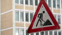 Men at work, under construction road traffic sign Stock Footage