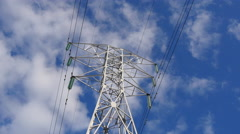 4K High-Voltage Power Lines in Clouds Stock Footage