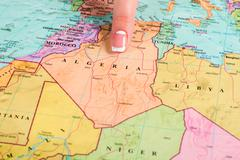 Female finger pointing at Algeria. Stock Photos