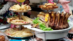 The food on the counter, tasty foods, fried ribs, pancakes, pies. Stock Footage