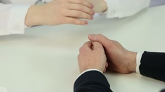 Supportive doctor holding patient's hands, telling bad news, sign of compassion Stock Footage