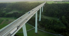 Drone footage of vehicles moving on Kocher Viaduct over green landscape, Stock Footage