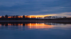 4k timelapse of sunset sky over lake waters Stock Footage