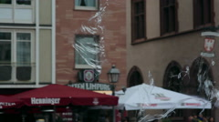 Huge magical soap bubble blows up, Römerberg square attraction, Frankfurt - stock footage