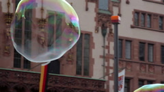 Majestic magical huge soap bubbles fly in the air, Frankfurt am Main, Germany - stock footage