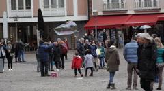 Children and tourists, man creates huge soap bubbles, Römerberg, Frankfurt Stock Footage