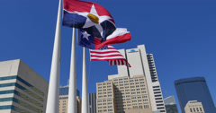 Three flags and Downtown Dallas skyline Stock Footage