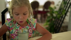Girl-preschooler drinking juice - stock footage