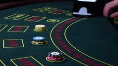 Stock Video Footage of Croupier deal cards on green table with chips, slow motion
