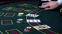 Stock Video Footage of Croupier deal cards on poker table with chips, slow motion