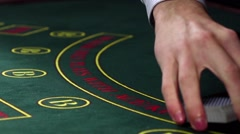 Stock Video Footage of Croupier shuffling poker playing cards on green table, slow motion